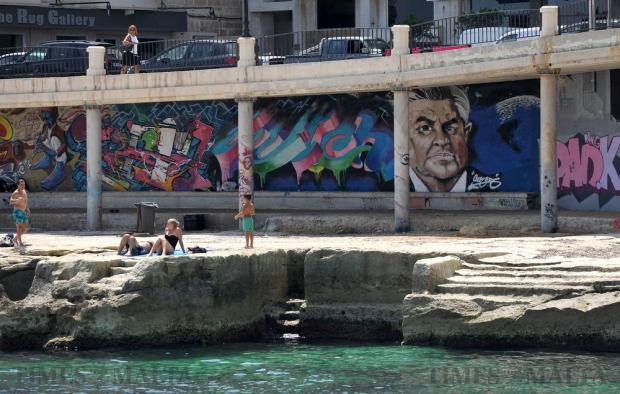 Graffiti embellish the Qui-Si-Sana promenade in Sliema on August 31. Photo: Chris Sant Fournier
