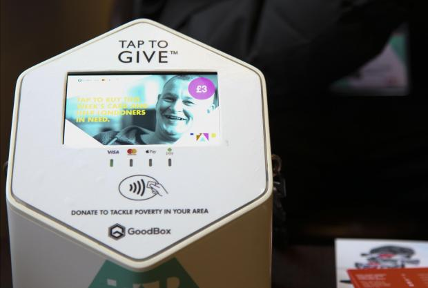 TAP London boxes allow commuters to tap and donate. Photo: Reuters