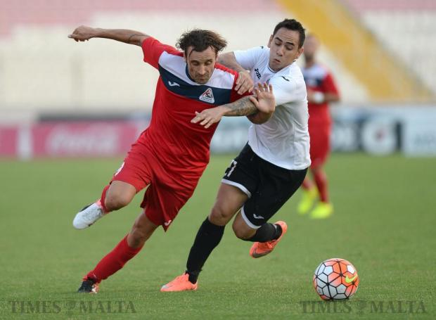 Pembroke Athleta's Mano Micallef (left) is challenged by Hibernians winger Renan Pimenta Telles during their Premier League football match at the National Stadium in Ta'Qali on September 17. Hibs came back from a goal down to win 2-1. Photo: Matthew Mirabelli