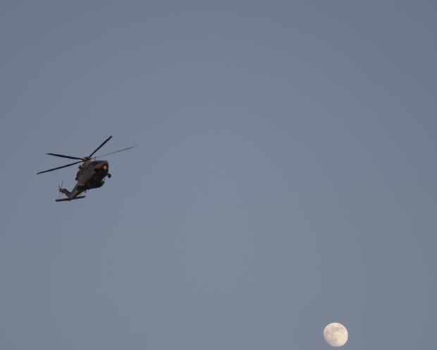 A Maltese Armed Forces Helicopter flies over Paola on the full Moon evening of July 6. Photo: Mark Zammit Cordina