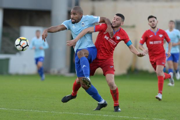 Jefferson (left) of Sliema Wanderers shields the ball from Balzan's Justin Grioli. Photo: Matthew Mirabelli
