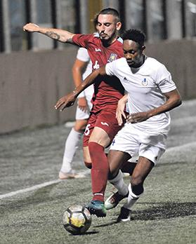 Sliema Wanderers' Frank Temile moves past Sasha Borg, of Gżira United. Photo: Chris Sant Fournier