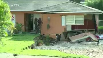 Watch home collapse into sinkhole. Video: Reuters