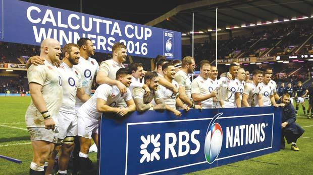 The England players at the end of the Six Nations tournament match against Scotland, at Murrayfield, yesterday.
