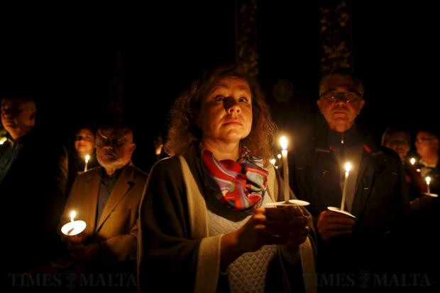 Believers hold candles during an Easter vigil mass at St John's Co-Cathedral in Valletta on March 26. Photo: Darrin Zammit Lupi
