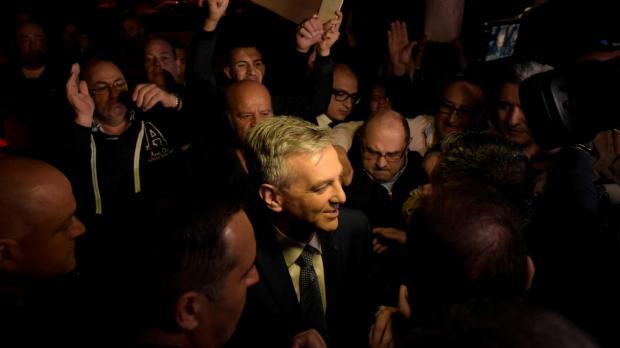 Simon Busuttil is mobbed as he enters the studio. Photo: Mark Zammit Cordina