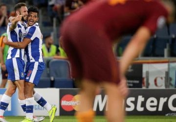 Nine-man Roma eliminated from Champions League