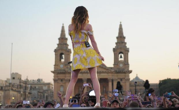 Sydney Sierota of Echosmith, the American Indie pop band best known for their hit Cool Kids, gets the 9th edition of the Isle of MTV concert off to a rocking start as dusk falls over the Granaries in Floriana on July 7 with the church of St Publius providing a majestic backdrop. Photo: Matthew Mirabelli