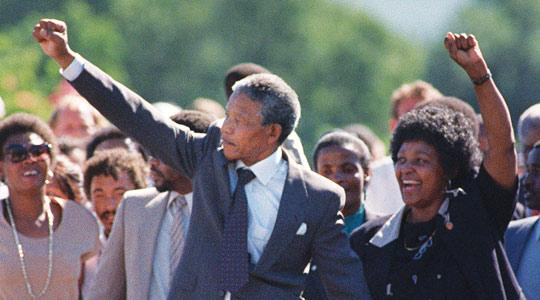 Nelson Mandela (centre) and his then-wife Winnie saluting a cheering crowd upon Mr Mandela's release from the Victor Verster prison near Paarl, on February 11, 1990. Photo: Alexander Joe/AFP.