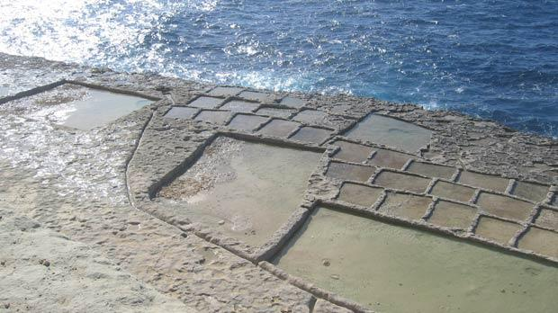 The salt pans and the shimmering blue sea at Blata Steps.