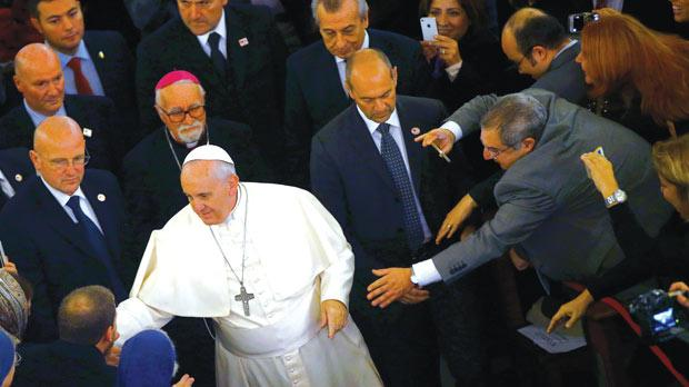A man reaching to touch Pope Francis at the Catholic Cathedral of the Holy Spirit in Istanbul, Turkey, yesterday. Photo: Reuters