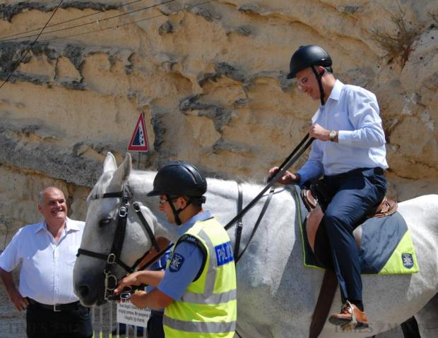 Home Affairs Minister Carmelo Abela gets a taste of what it's like to be a mounted policeman during the police day activities held at Notre Dame Ditch in Floriana on July 4. Photo: Mark Zammit Cordina