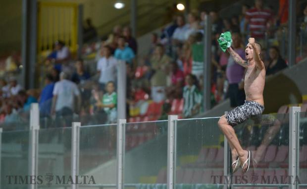 A Floriana fan celebrates his team's win against Pembroke Athleta at the Hibernians Stadium in Corradino on August 20. Photo: Matthew Mirabelli
