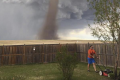 Canadian mows his lawn as tornado rages behind him