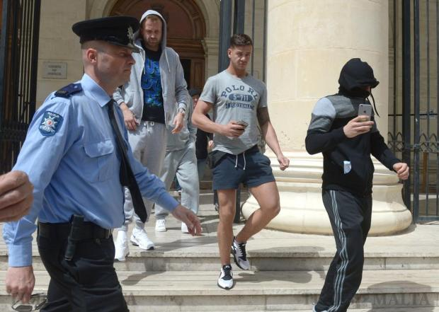 A group of Scots exit the court in Valletta on April 1, after being charged with causing mayhem on a Ryanair flight to Malta earlier in the week. Photo: Matthew Mirabelli