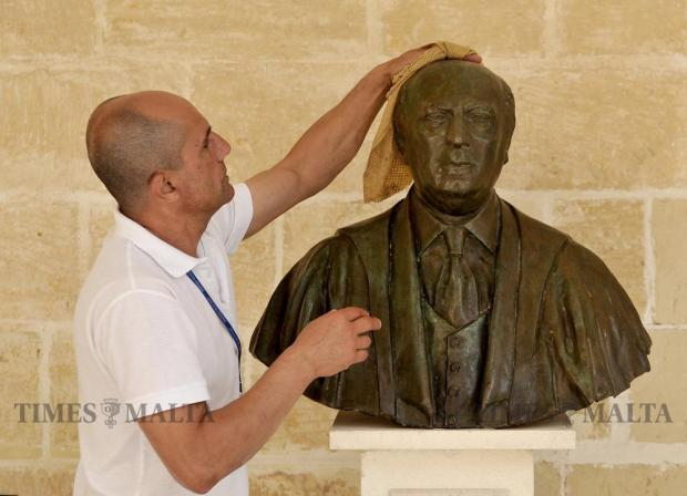 A man polishes the bust of ex-President and politician Guido de Marco at the President's Palace at San Anton on May 30. Photo: Chris Sant Fournier