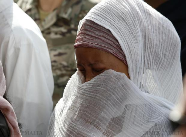 A migrant cries during an inter-faith burial service for 24 dead migrants at Mater Dei Hospital in Tal-Qroqq on April 23. European Union leaders who decided last year to halt the rescue of migrants trying to cross the Mediterranean reversed their decision at a summit hastily convened after nearly 2,000 people died at sea. Public outrage over the deaths peaked this week after up to 900 migrants died when their boat sank on its way to Europe from Libya. Photo: Darrin Zammit Lupi