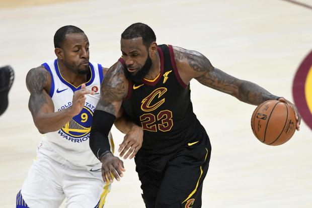 Cleveland Cavaliers forward LeBron James (23) controls the ball against Golden State Warriors forward Andre Iguodala (9) in the third quarter at Quicken Loans Arena. Photo: David Richard-USA TODAY Sports