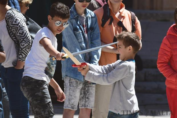 Children play with toy swords during Medieval Mdina, a celebration of the ancient city's past on 30 April Photo : Jonathan Borg