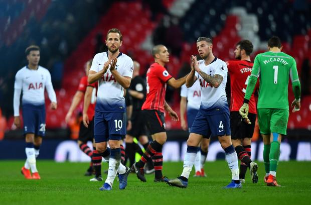Tottenham's Harry Kane and Toby Alderweireld applaud their fans after the match.