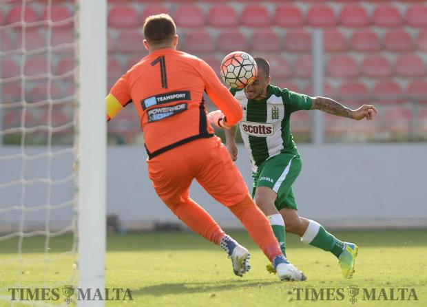 Floriana captain Nicolas Chiesa (right) rushes in to beat Mosta keeper, Yenz Cini to the ball during their BOV premiership match at the Hibernians Stadium in Kordin on April 29. Photo: Matthew Mirabelli