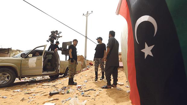 Forces loyal to the internationally-recognised Government of National Accord (GNA) take a position during clashes with forces loyal to strongman Khalifa Haftar south of Tripoli's suburb of Ain Zara on Tuesday. Photo: Mahmud Turkia/AFP