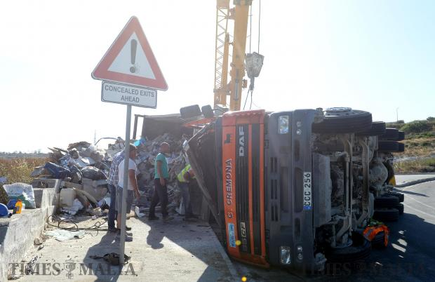 A truck lies on its side after overturning on the T'Alla u Ommu hill in Naxxar on May 5. Photo: Matthew Mirabelli