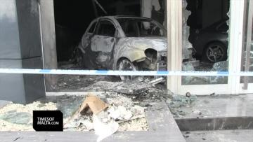 High-end cars damaged in car showroom fire
