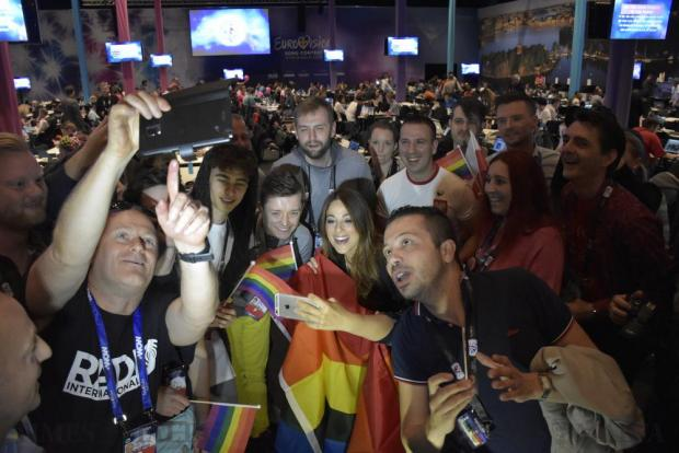 Ira Losco takes photos with fans and members of the press after she gave a press conference regarding LGBT rights at the Eurovision press centre in Stockholm, Sweden, on May 12. Photo: Mark Zammit Cordina