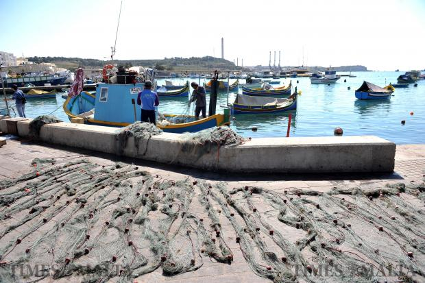 Fishing nets are prepared for the next catch at Marsaxlokk on March 28. Photo: Chris Sant Fournier