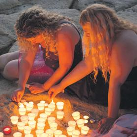 Lighting candles in solidarity on the Sliema front.