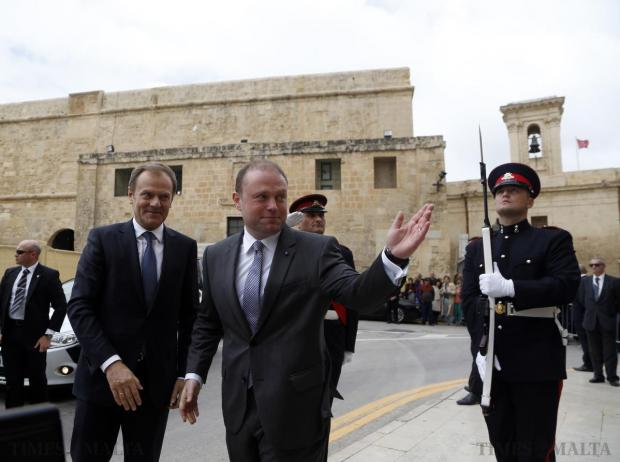 Malta's Prime Minister Joseph Muscat (centre) welcomes the President of the European Council, Donald Tusk (left) outside his office at the Auberge de Castille in Valletta on March 30. They discussed the situation in Libya, immigration and ways to stabilise the region. Photo: Darrin Zammit Lupi