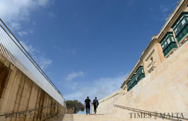 A couple make there way up the steps to the bastions at the entrance to Valletta on February 18. Photo: Matthew Mirabelli