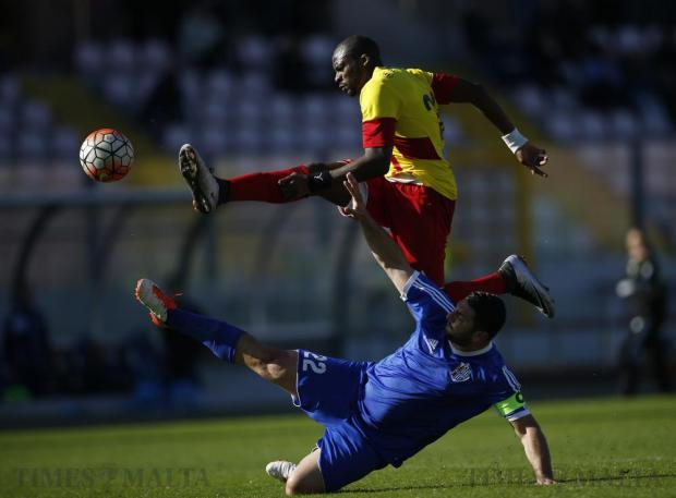 Birkirkara's L'Imam Seydi shoots the ball as Mosta's Tyrone Farrugia tries to block during their Premier League football match at the National Stadium in Ta' Qali on February 21. Photo: Darrin Zammit Lupi