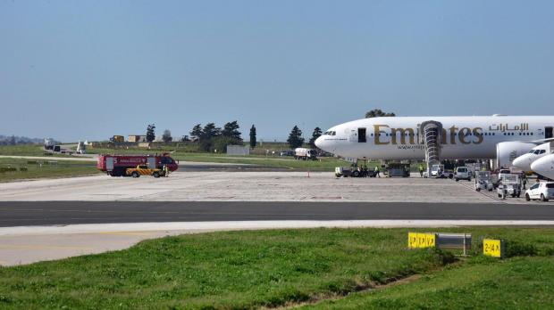 A fire truck parked close to the plane that caught fire. Photo: Mark Zammit Cordina