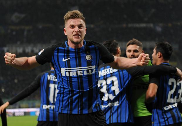 nter Milan's Milan Skriniar celebrates scoring their first goal with team mates.