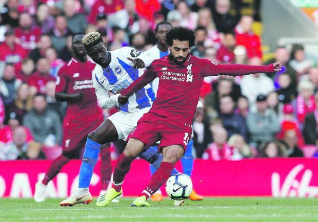Mohammed Salah (right) scored the winner for Liverpool against Brighton.