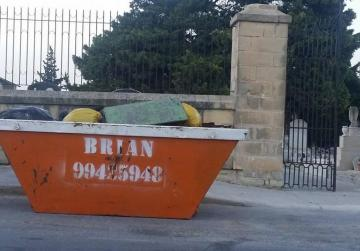 Skip full of coffin remains infuriates residents
