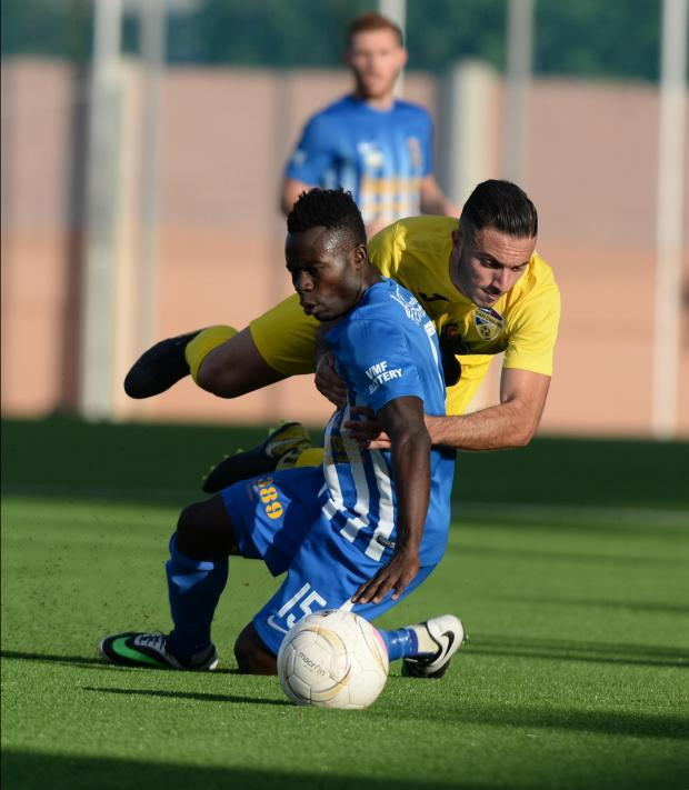 Pieta's Godwin Mensah, is brought down by the San Gwann defence during their Division 1 match against San Gwann at the Centenary Stadium in Ta'Qali on November 19. Photo: Matthew Mirabelli