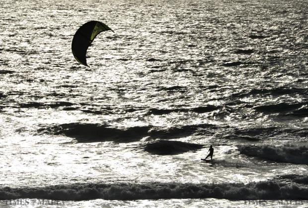 A Kite Surfer flashes above the waves at Golden Bay on February 10. Photo: Chris Sant Fournier