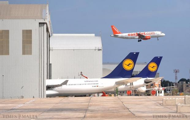 An Easyjet Airbus on its final approach to Malta International Airport flies past the Lufthansa Technik hangers on October 26. Photo: Chris Sant Fournier
