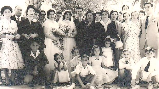 A wedding reception at the Regina Hotel in the mid-1950s. The author, still a boy, is in the front row, far left. His parents are in the third row, also on far left.