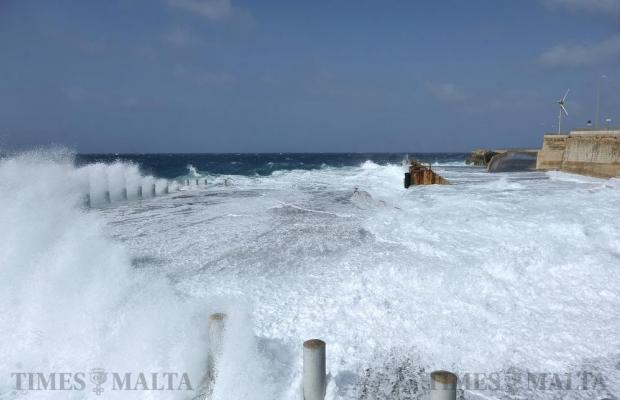 A wave washes over the quay at Cirkewwa on April 8. Photo: Chris Sant Fournier