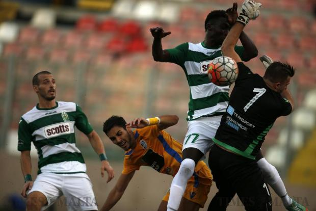 Floriana's Amadou Samb (2nd right) collides with Mosta goalkeeper Yenz Cini during their Premier League football match at the Tedesco Stadium in Hamrun on October 22. Photo: Darrin Zammit Lupi