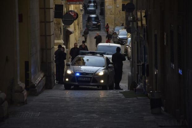 Two members of the Rapid intervention Unit (RIU) cordon off the road leading to the back entrance of the courthouse in Valletta. Photo: Mark Zammit Cordina