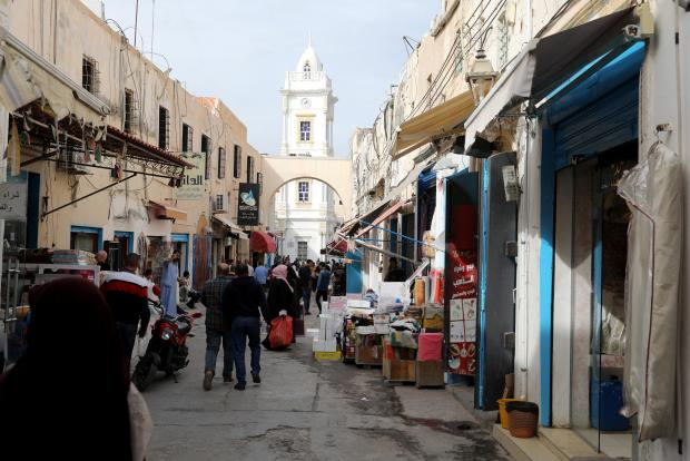 People shop at a market in the old city of Tripoli.