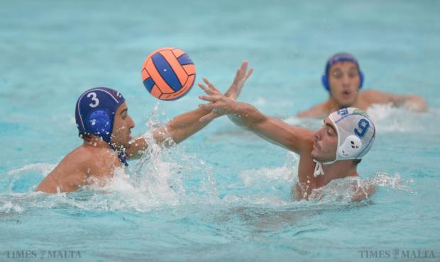 Italy's Jocopo Alesiani tries to get a shot passed Serbia's Filip Jankovic during their U-20 Comen Cup waterpolo match at the National Pool in Tal'Qroqq on August 16. Photo: Matthew Mirabelli