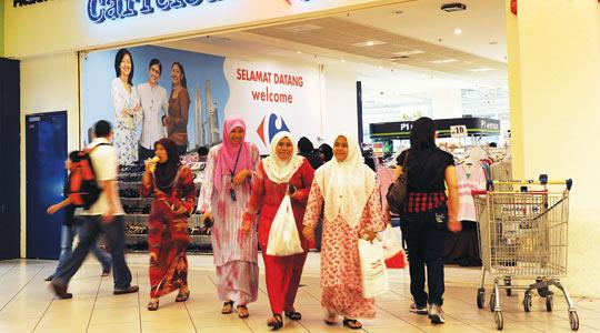 Malaysian shoppers leaving the French supermarket Carrefour in Kuala Lumpur. Photo:AFP
