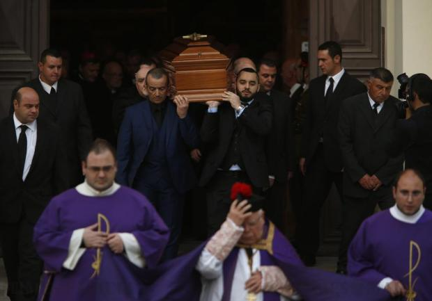 The coffin of Archbishop Emeritus Joseph Mercieca is carried out of St John's Co-Cathedral after his funeral Mass in Valletta on March 23. Photo: Darrin Zammit Lupi
