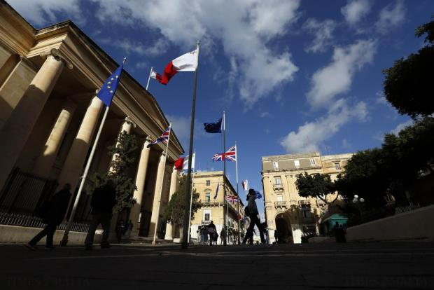 British, Maltese and European Union flags adorn Valletta's Republic Street to celebrate the upcoming Commonwealth Heads of Government Meeting (CHOGM) and visit to Malta by Britain's Queen Elizabeth II on November 25. Photo: Darrin Zammit Lupi